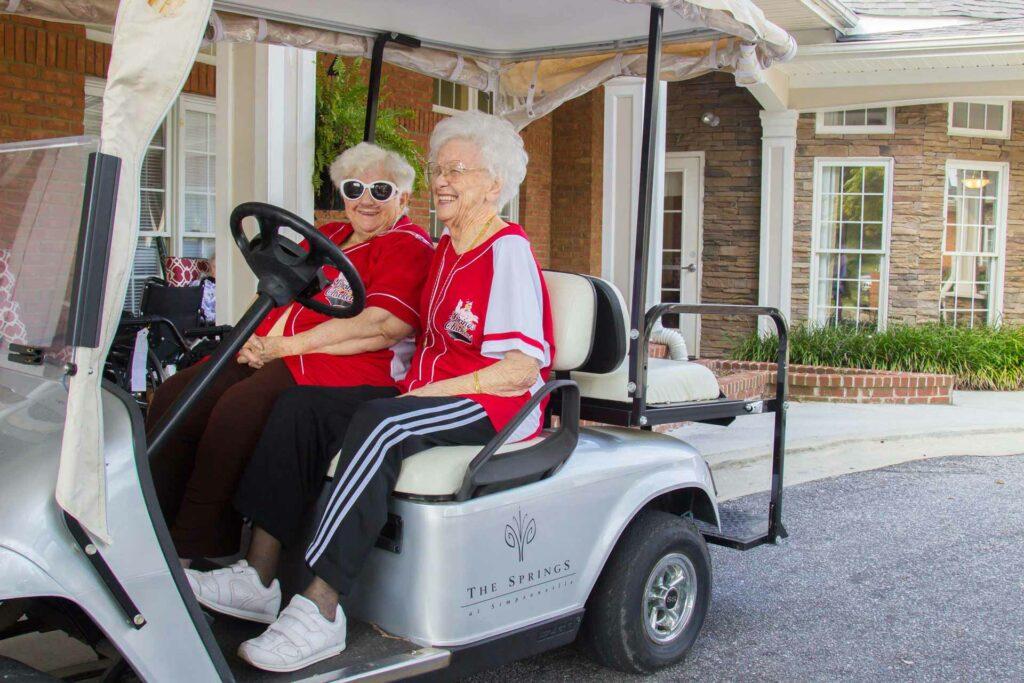 Senior Residents having fun on golf cart