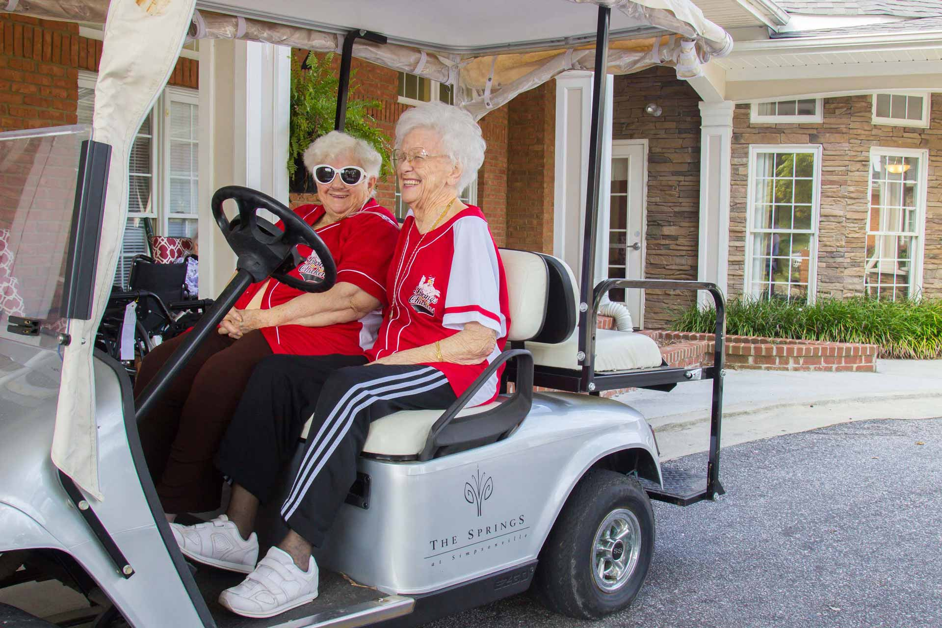 Senior Residents having fun on golf cart