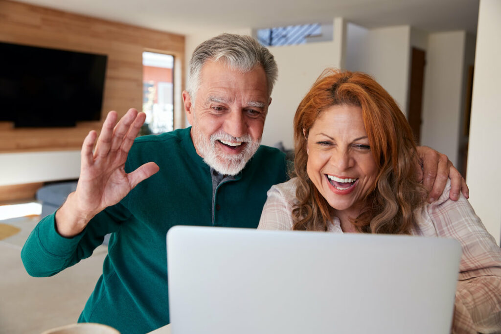 senior couple staying virtually connected through video chat