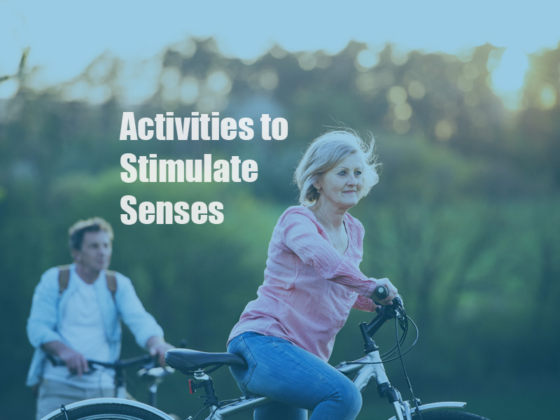 beautiful-senior-couple-with-bicycles-outside-in-PYSADTQ