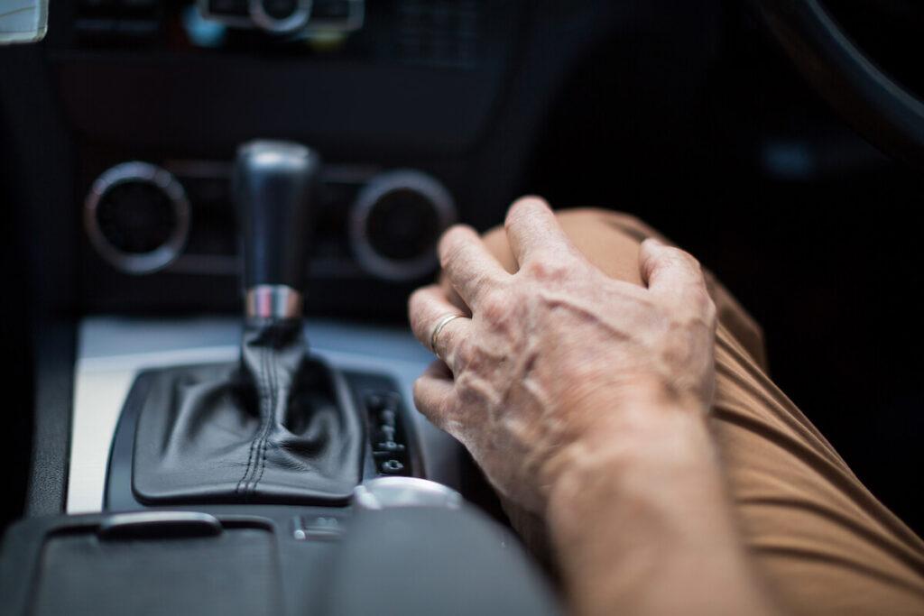 senior man driving car